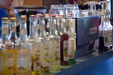 Four Friends - Monin syrup bottles and espresso machine